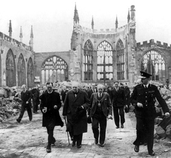 In 1942, Churchill visits the ruins of Coventry Cathedral. He frequently visited bomb sites to encourage his countrymen and women not to give up.