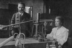 Marie and Pierre Curie in their laboratory