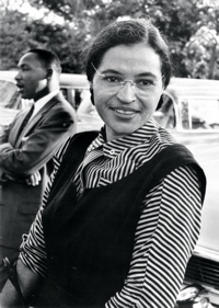 Rosa Parks during the Montgomery bus boycott with Martin Luther King Jr in the background
