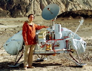 Carl Sagan in the mid 1970s with a model of the Mars-bound Viking Lander