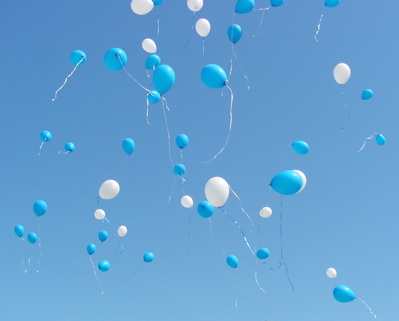 Balloons launch themselves into the endless blue sky