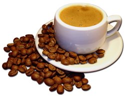 A white cup of coffee with coffee beans scattered around it